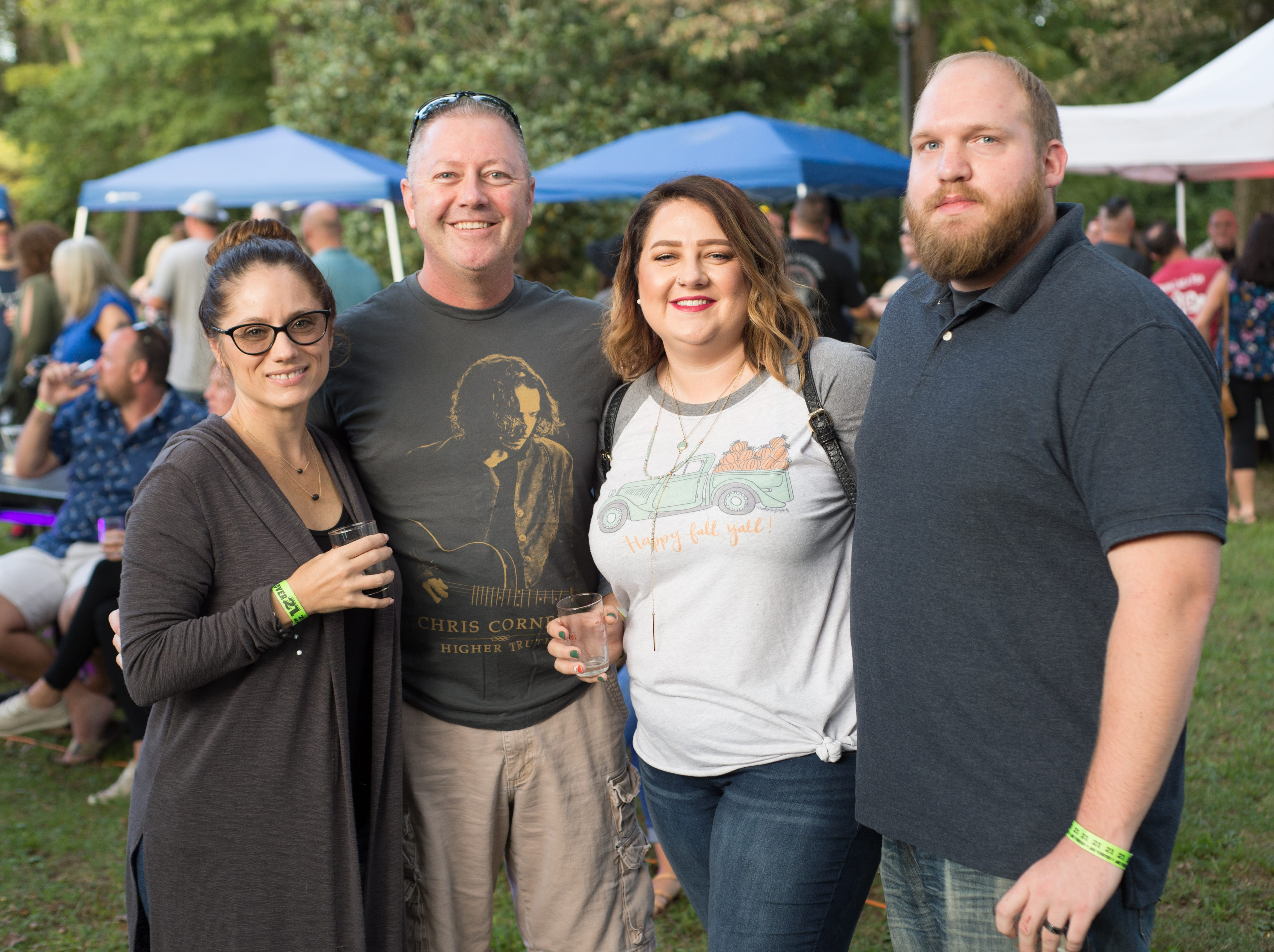 Kimberly Thornhill, Mike Roberts, Amber and Jonathan Clover pause for a photograph during Oktoberfest at Oaklands Mansion in Murfreesboro on Saturday, Sept. 29.