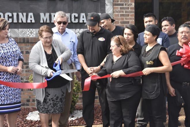Alicia Camarena cut the ribbon for her family's new restaurant, named in honor of her late husband. It was her first time coming to the U.S. from Mexico since he died five years ago.