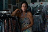 Artist and designer Jane Vallejo in her boutique/art studio called Art Mosaic Fashion & Art Gallery in Naples paints a few months after her art was plagiarized and sold at a flea market.