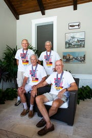 Kraft Schepke, from left, Chuck Roth, Peter Narvestad, and Peter Bos pose for a portrait in Naples on Monday, Oct. 1, 2018. The four men competed together as teammates at a rowing event in Sarasota.
