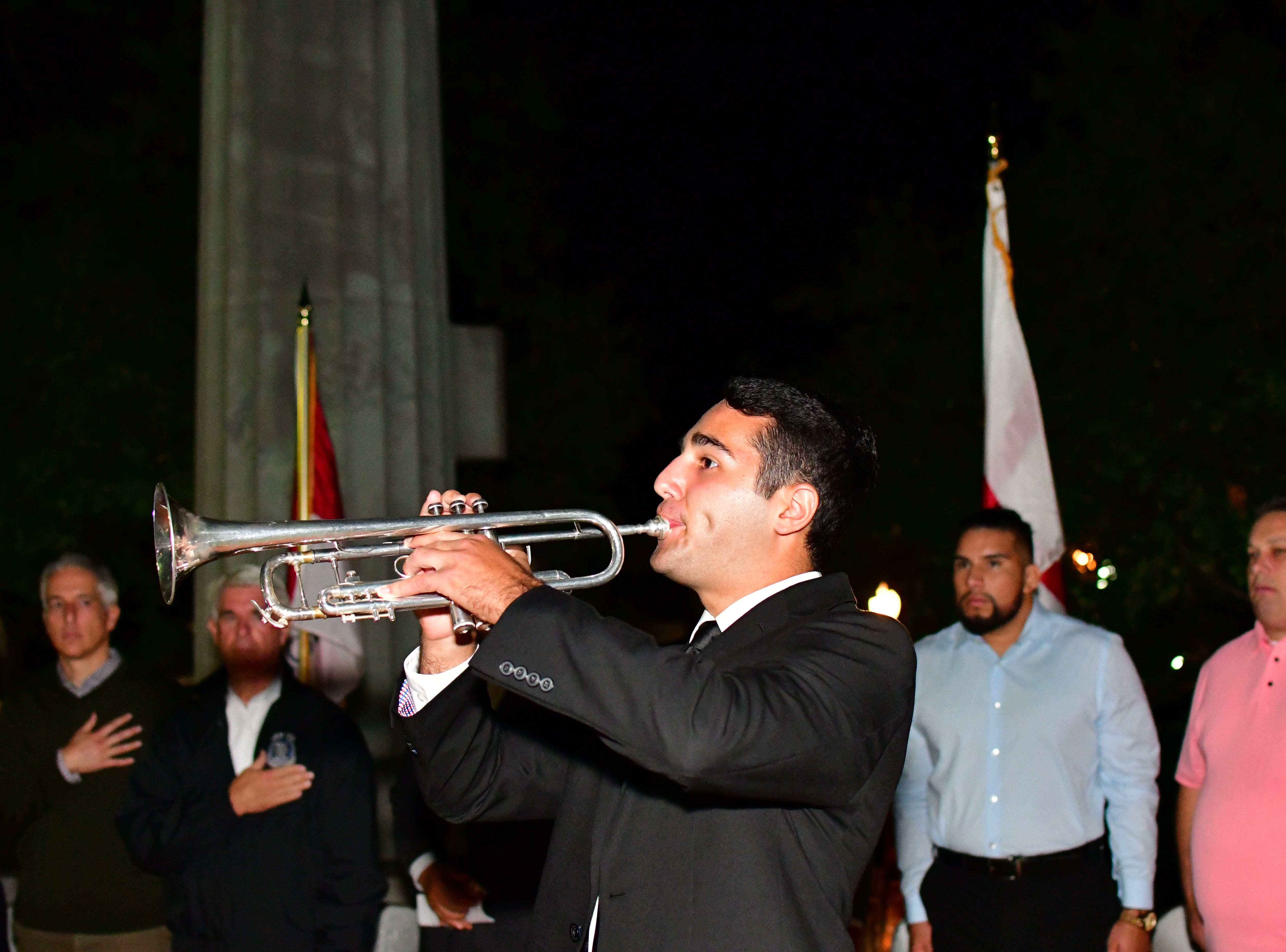 Sean Zuckerman plays TAPS on trumpet.  The Gold Star Mother's Day Committee sponsored its eighth annual event commemorating Gold Star Mother's Day on Sept. 30, at Van Neste Park, Ridgewood. After a short ceremony, hundreds of luminaries were lit to honor Gold Star Mothers (moms who had lost sons and daughters to the war) and their families.
