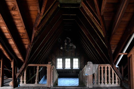 The Bamberger Mansion is for sale in West Orange, NJ. The view of the staircase and chandelier on the third floor.