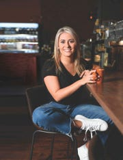 Ava Economou, 17 of Wayne, poses with coffee in The Fine Grind- A Coffee Bar in Wayne