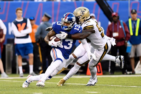 New York Giants wide receiver Odell Beckham Jr. (13) is tackled by New Orleans Saints linebacker Demario Davis (56) in the second half. The New Orleans Saints defeat the New York Giants 33-18 on Sunday, September 30, 2018 in East Rutherford, NJ.