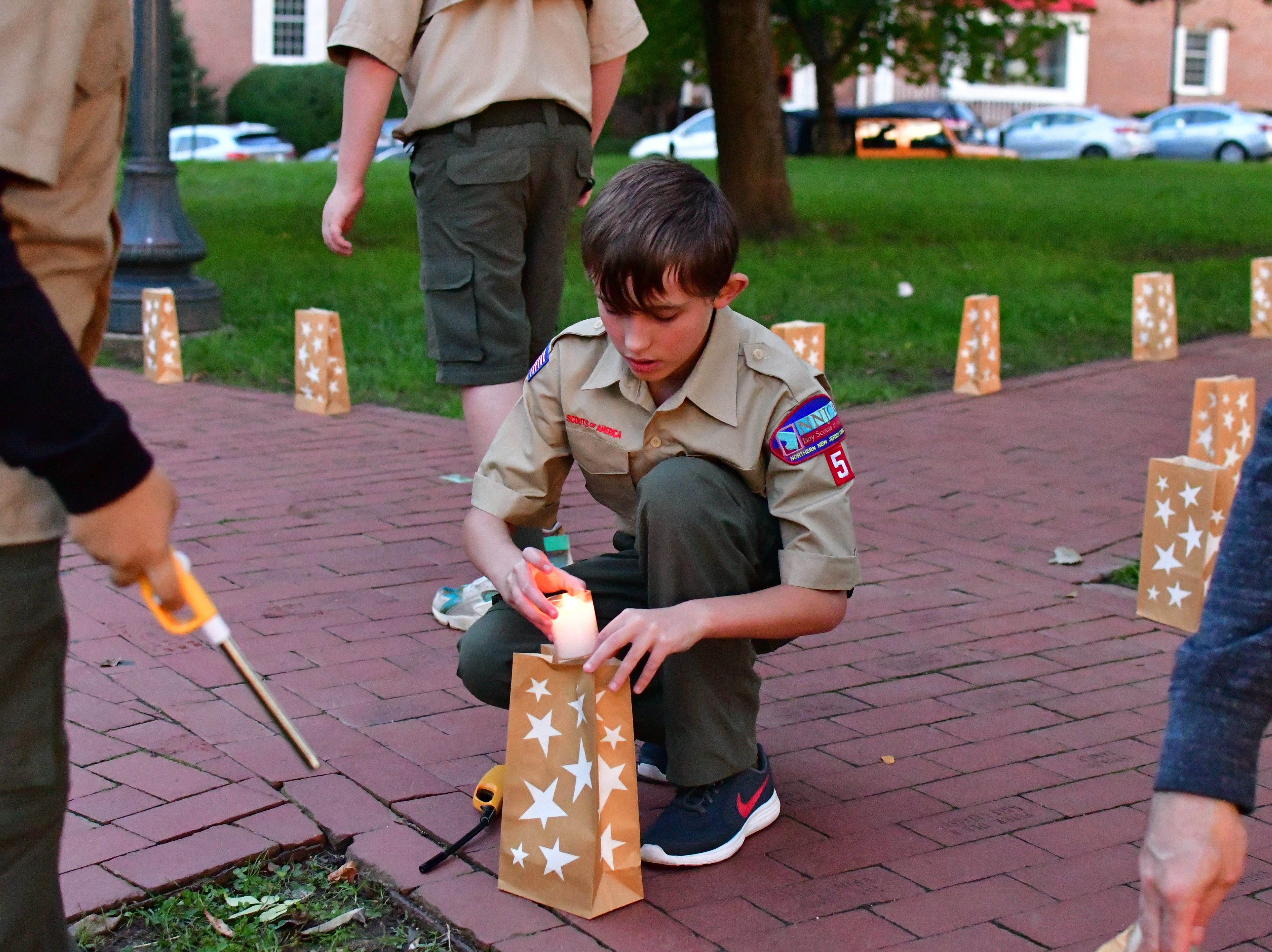 Boy scouts who helped light the luminaries. The Gold Star Mother's Day Committee sponsored its eighth annual event commemorating Gold Star Mother's Day on Sept. 30, at Van Neste Park, Ridgewood. After a short ceremony, hundreds of luminaries were lit to honor Gold Star Mothers (moms who had lost sons and daughters to the war) and their families.