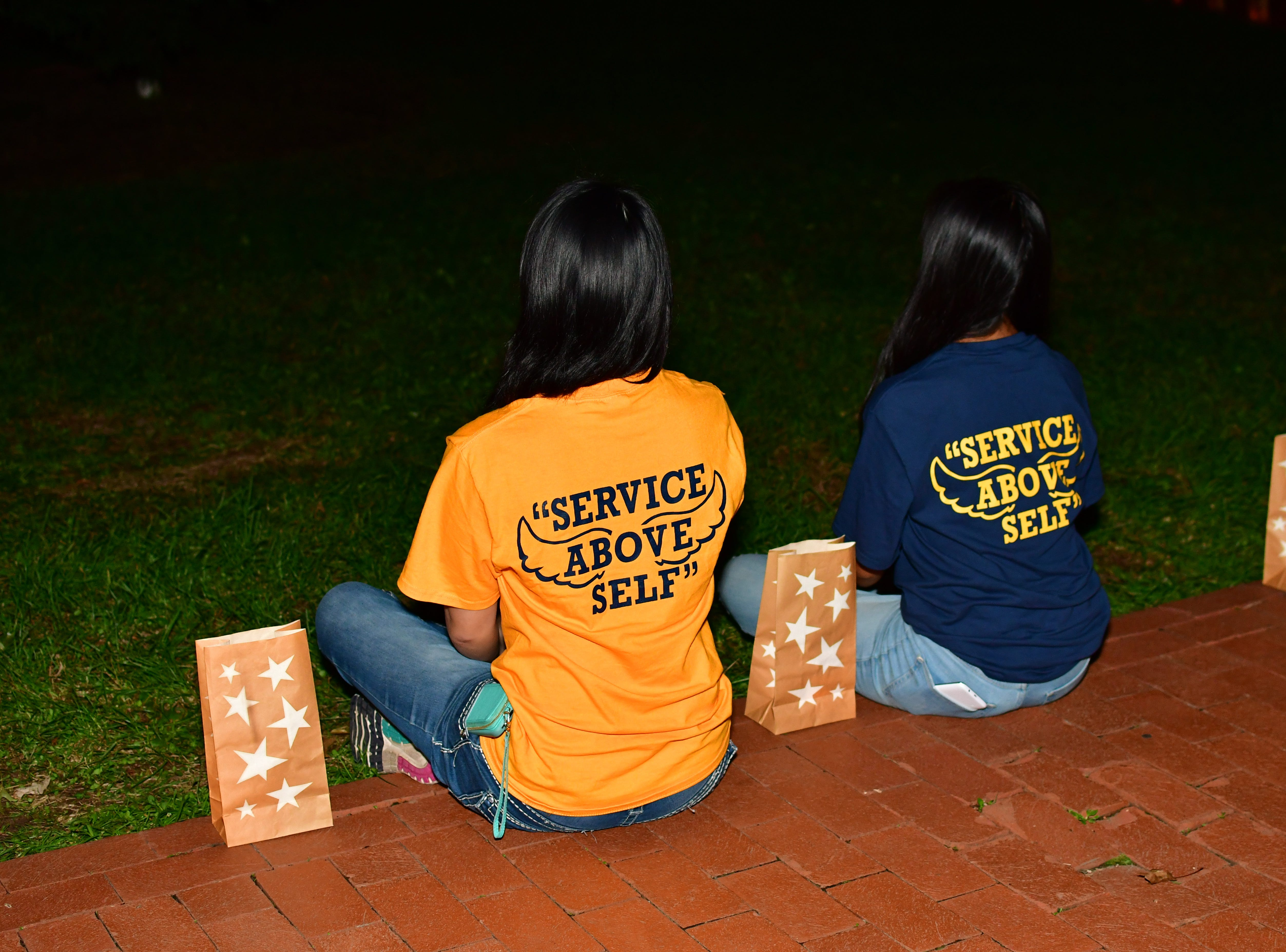 Vanessa Cheng, left, and Daisy Torres, right.  The Gold Star Mother's Day Committee sponsored its eighth annual event commemorating Gold Star Mother's Day on Sept. 30, at Van Neste Park, Ridgewood. After a short ceremony, hundreds of luminaries were lit to honor Gold Star Mothers (moms who had lost sons and daughters to the war) and their families.