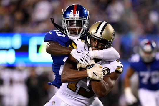 New York Giants cornerback Janoris Jenkins (20) tackles New Orleans Saints wide receiver Michael Thomas (13) in the second half. The New Orleans Saints defeat the New York Giants 33-18 on Sunday, September 30, 2018 in East Rutherford, NJ.