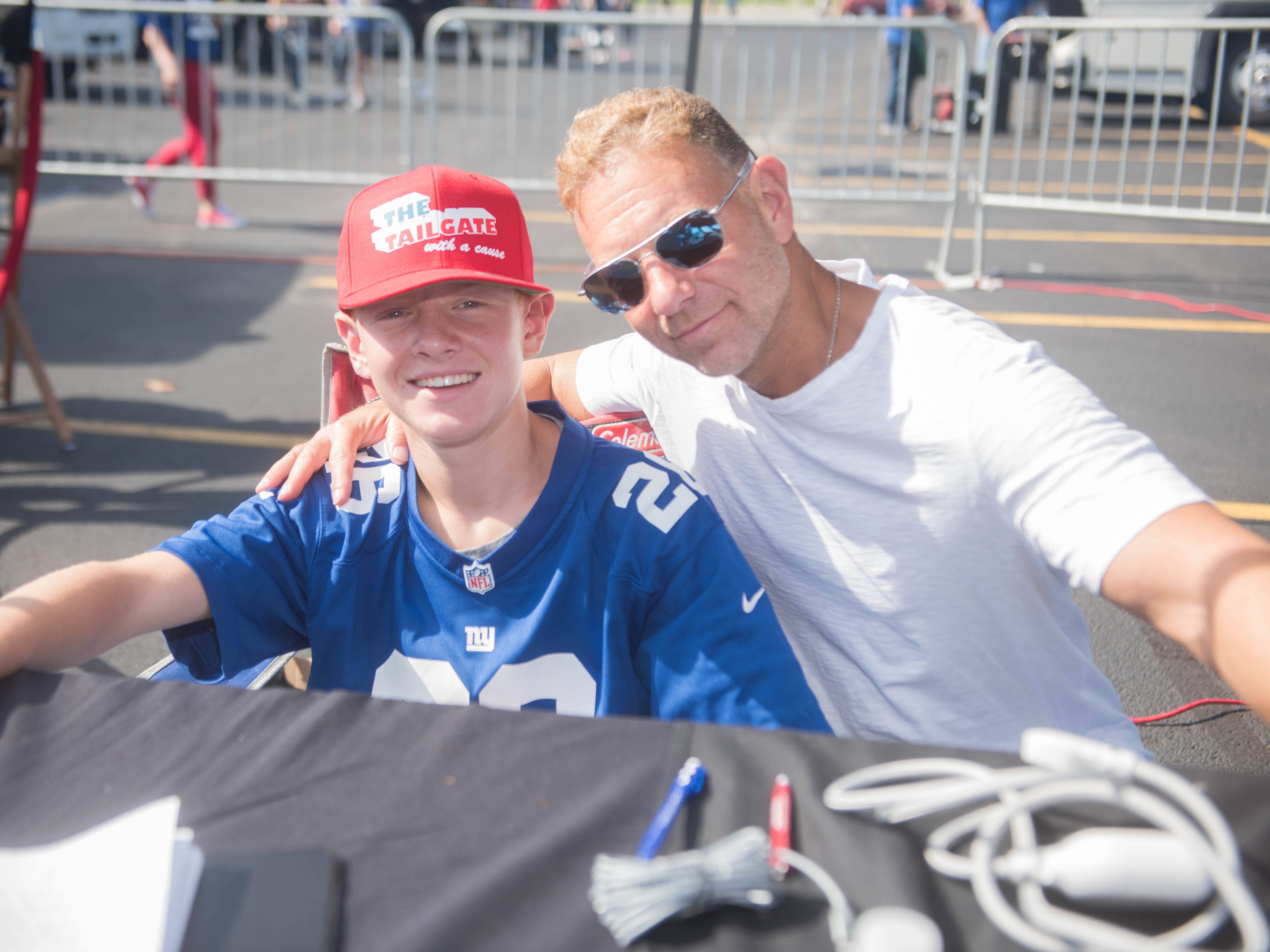 Ryan Kolin and Michael Kolin of the Section 16H Tailgate.org at the Giants vs. Saints tailgate party, Sunday, Sept. 30, 2018.