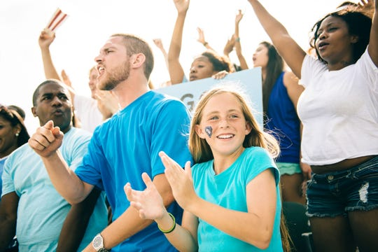 Fans cheer on sporting event