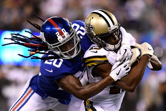 New York Giants cornerback Janoris Jenkins (20) tackles New Orleans Saints wide receiver Michael Thomas (13) just short of the endzone in the second half. The New Orleans Saints defeat the New York Giants 33-18 on Sunday, September 30, 2018 in East Rutherford, NJ.