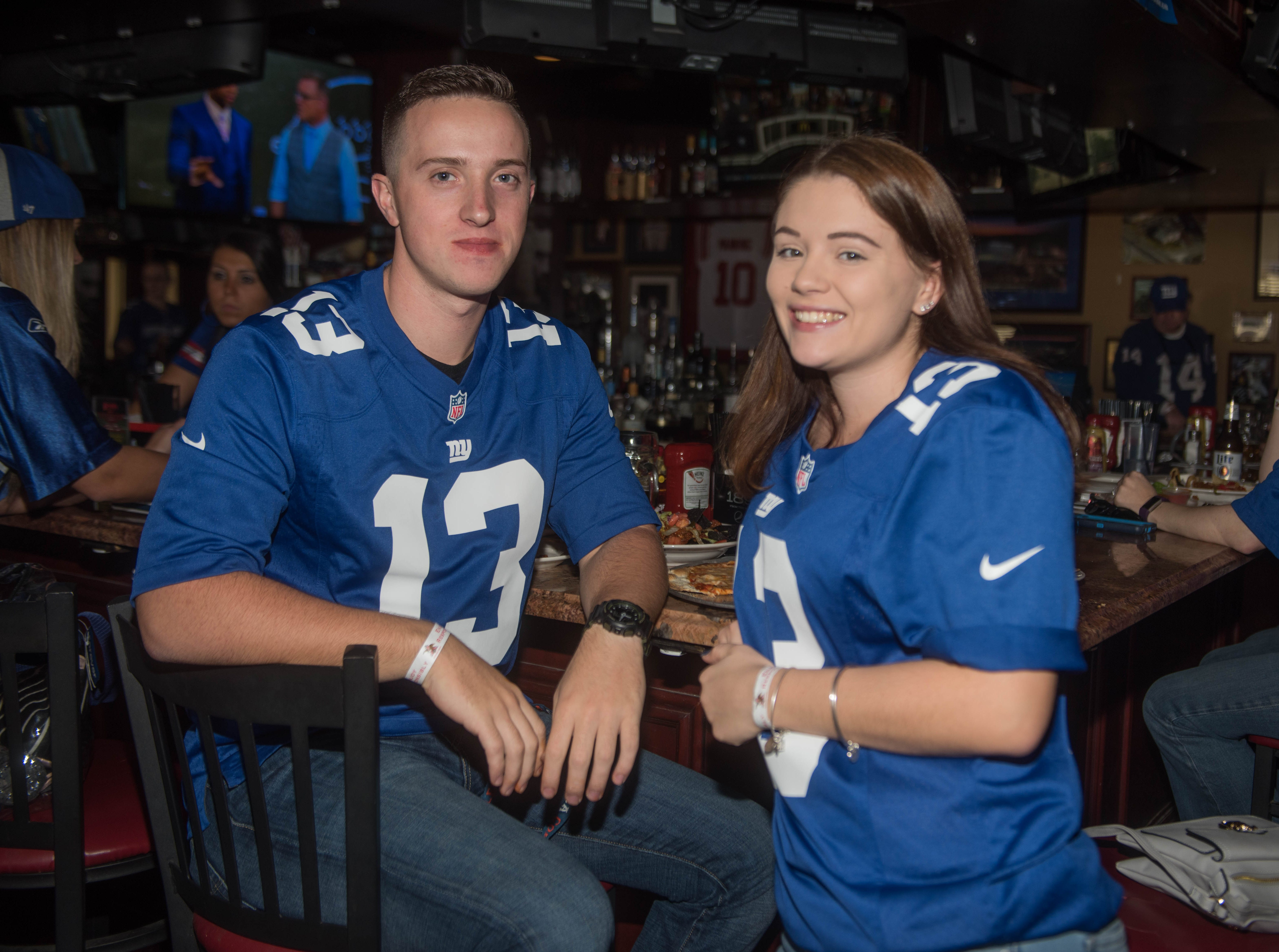 Tim White and Emily McCloskey. The Record sports writers Art Stapleton and Dave Rivera joined fans at Redd's to talk Giants and Saints before the game. 09/30/2018