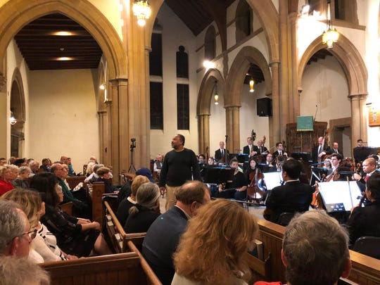 """Geoff Owens giving Macbeth's soliloquy at the Montclair Orchestra's """"A Shakespeare Evening."""" September 30, 2018."""