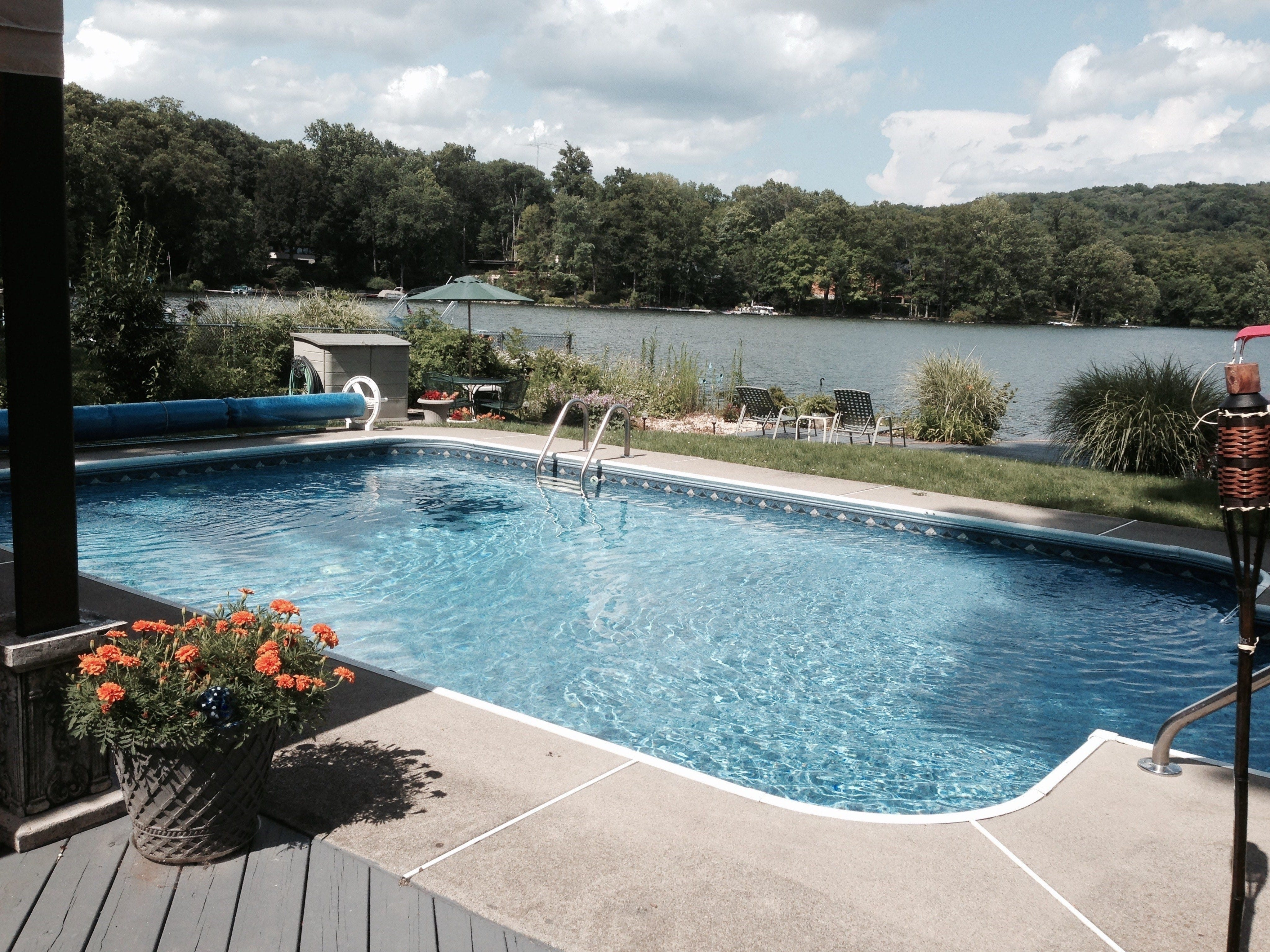 The backyard in-ground pool overlooks the water, and has been the ideal setting for entertaining.