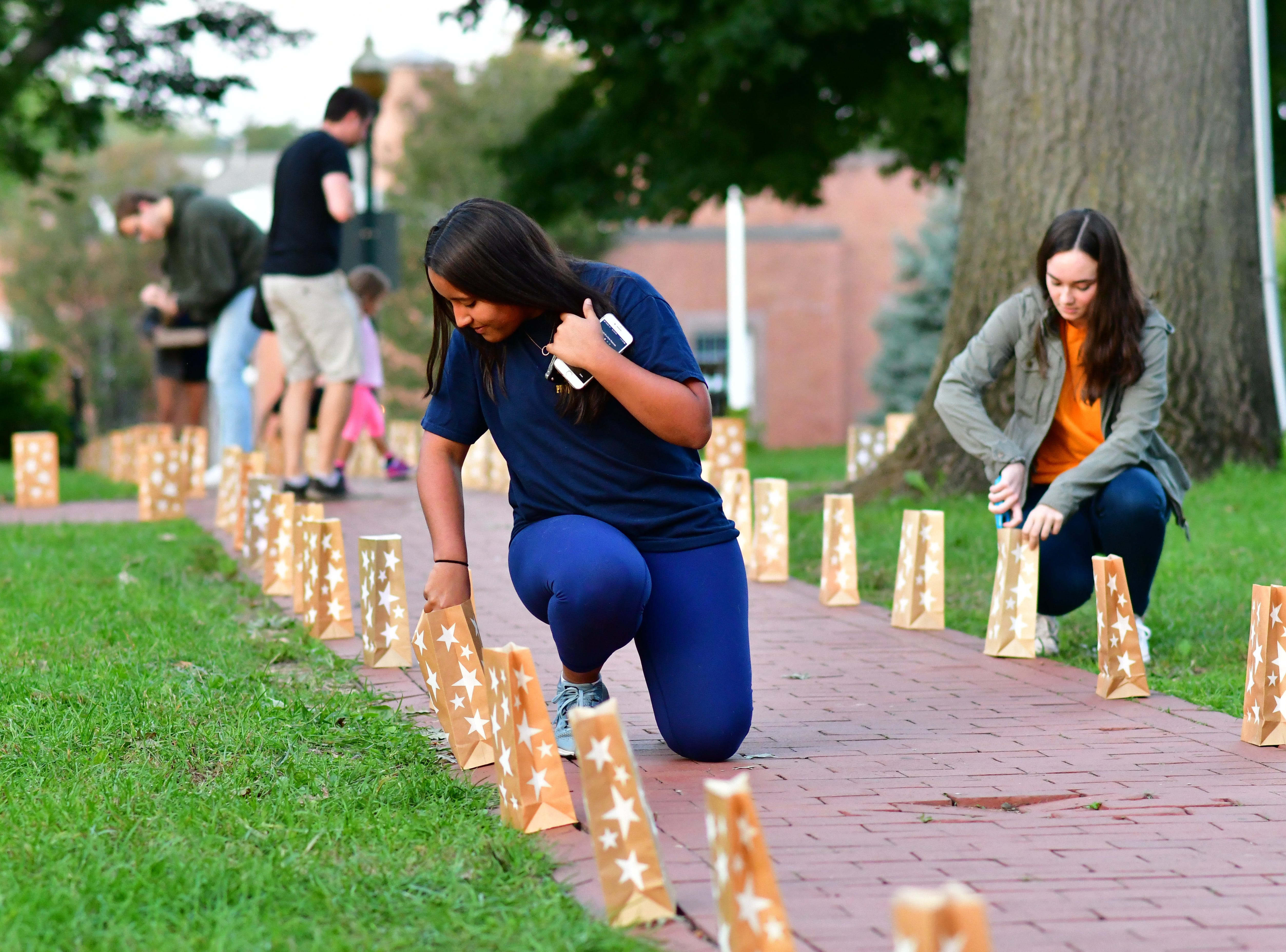 Francesca Chinea, left.  The Gold Star Mother's Day Committee sponsored its eighth annual event commemorating Gold Star Mother's Day on Sept. 30, at Van Neste Park, Ridgewood. After a short ceremony, hundreds of luminaries were lit to honor Gold Star Mothers (moms who had lost sons and daughters to the war) and their families.