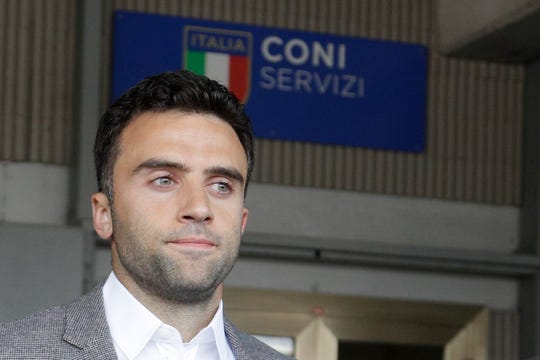 Soccer player Giuseppe Rossi leaves after being heard by a CONI (Italian Olympic committee) anti-doping commission, in Rome, Monday, Oct. 1, 2018. (AP Photo/Andrew Medichini)
