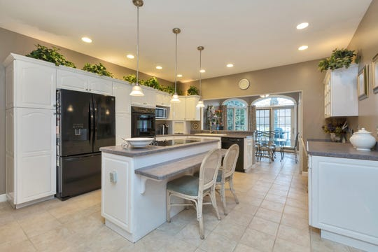 The large eat-in kitchen shown here has a separate dining area that connects to the family room.