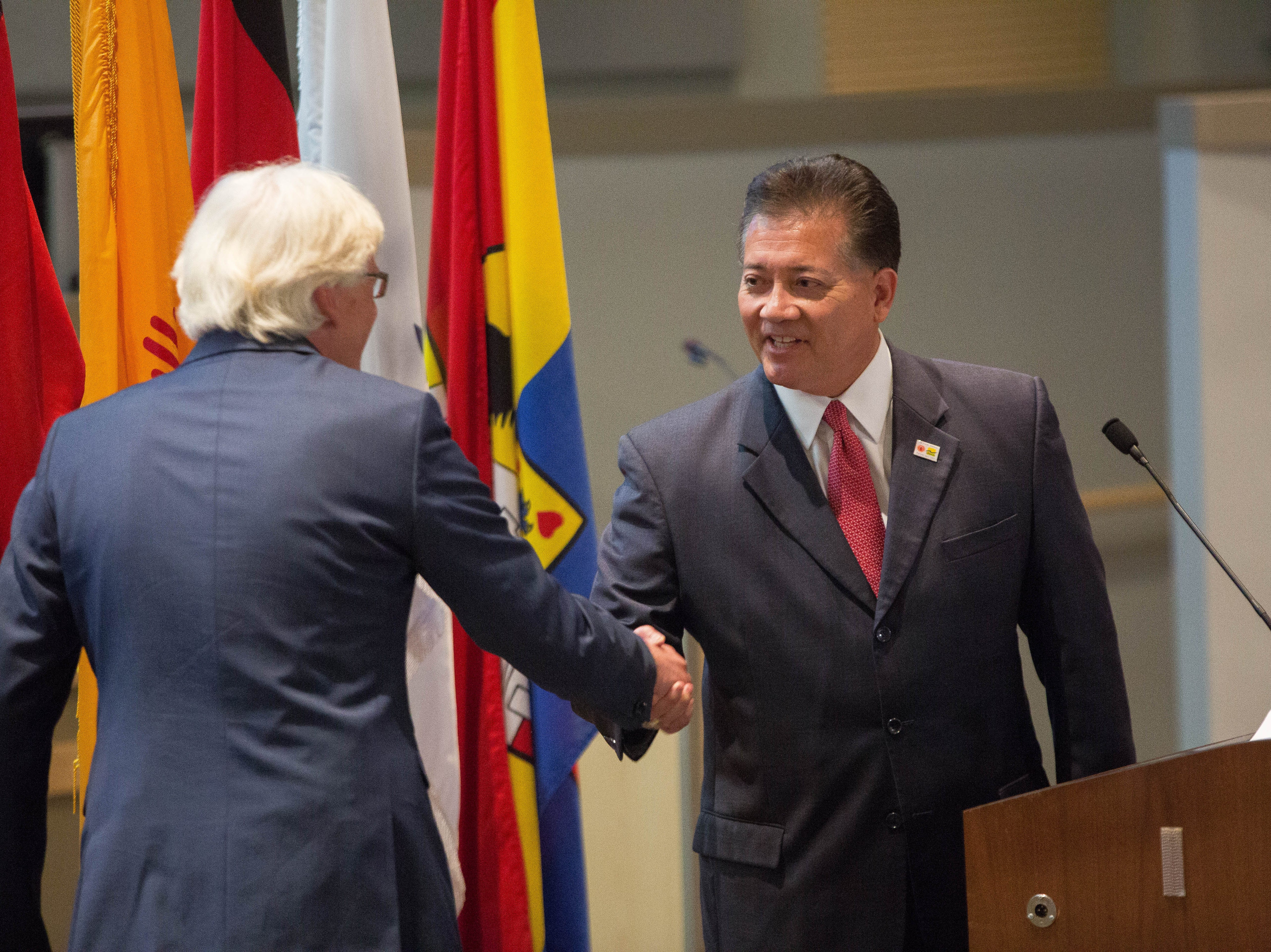 Ken Miyagishima, mayor of Las Cruces, shakes hands with Henning Onkes, the mayor of Nienburg, Germany.  The city of Las Cruces and representatives of Las Cruces' sister city Nienburg  Germany re affirmed the sister cities status, Monday, October 1, 2018, before the city council meeting at the Las Cruces City Council Chambers.