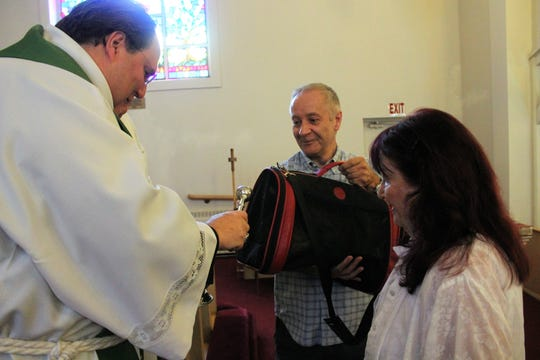 The Rev. John Stott of St. Michael and All Angels Anglican Church in Kerrville, Texas blesses a cat at the annual Blessing of the Animals at St. John's Episcopal Church in Alamogordo Sunday.