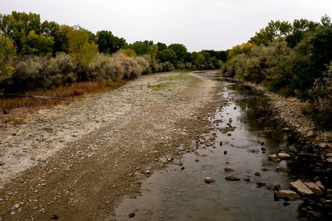 The Animas River is pictured, Monday, Oct. 1, 2018 from the footbridge near Animas Park in Farmington.