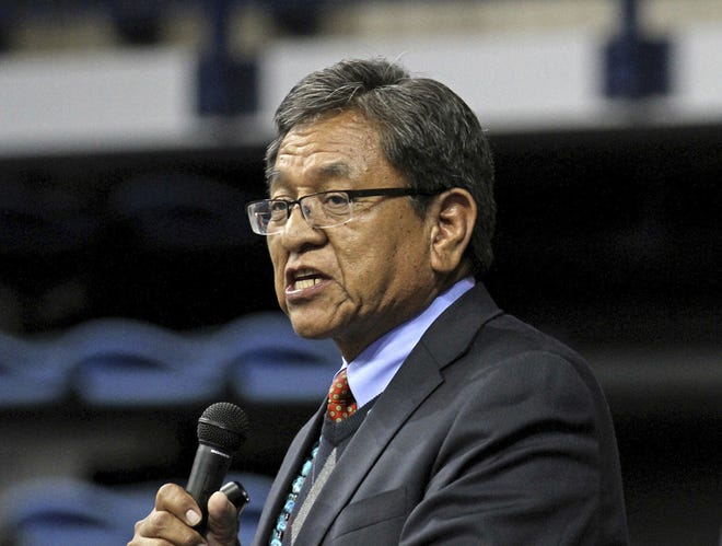 In this May 12, 2015, file photo, Navajo Nation President Russell Begaye gives his inaugural speech at Fighting Scouts Events Center in Fort Defiance, Ariz.