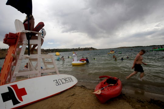 A life guard watches The Beach swimming area, Thursday, June 14, 2018 at Farmington Lake.
