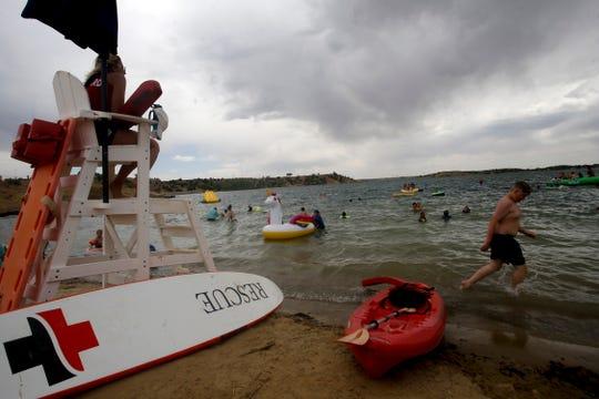 A life guard watches The Beach swimming area, Thursday, June 14, 2018 at Farmington Lake.