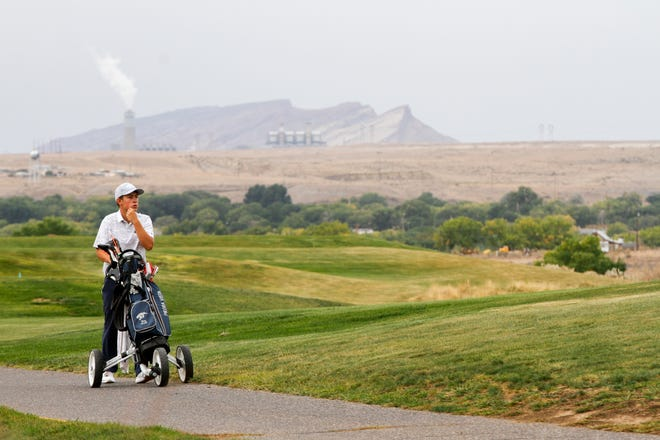 Trey Diehl walks to the next hole in October 2018 during the Chuck Soria Invitational Golf Meet at the Riverview Golf Course in Kirtland. The County Commission voted 4-1 in favor of increasing gross receipts taxes rather than cutting services, which could have meant closing the golf course.