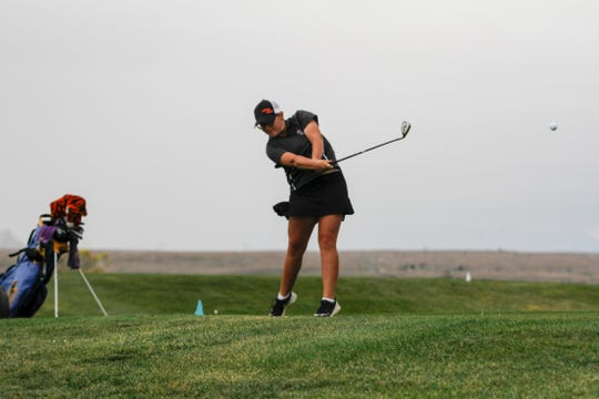 Aztec's Isabelle Peralta tees off, Monday, Oct. 1, 2018 at the Riverview Golf Course in Kirtland.