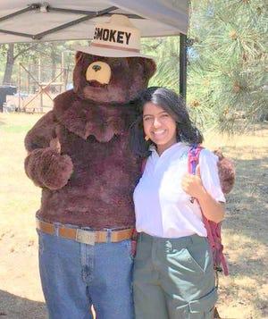 Roxanna Ayala bids goodbye to Smokey Bear.