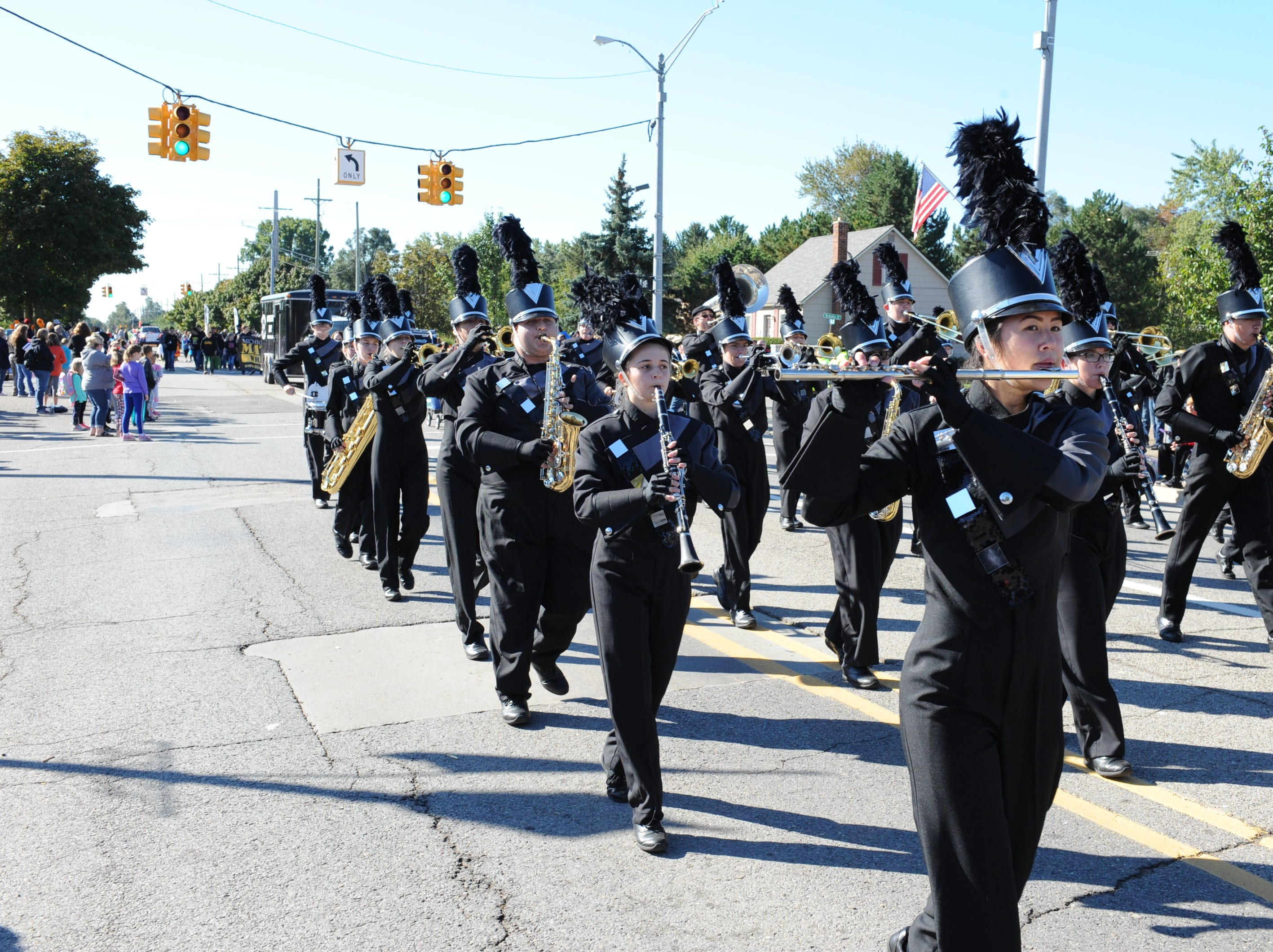 The South Lyon East High School marching band entertains the crowds.
