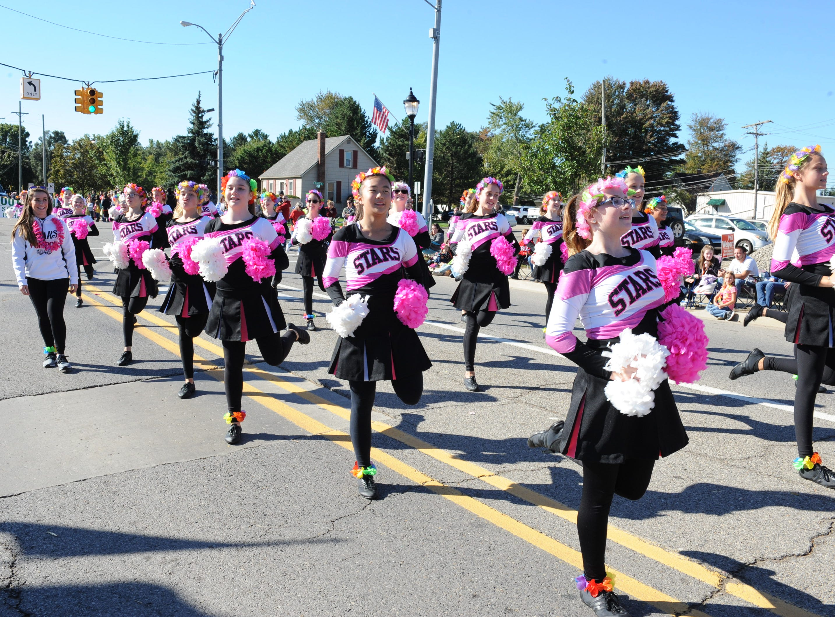 The South Lyon Stars pom team takes to the streets of South Lyon.