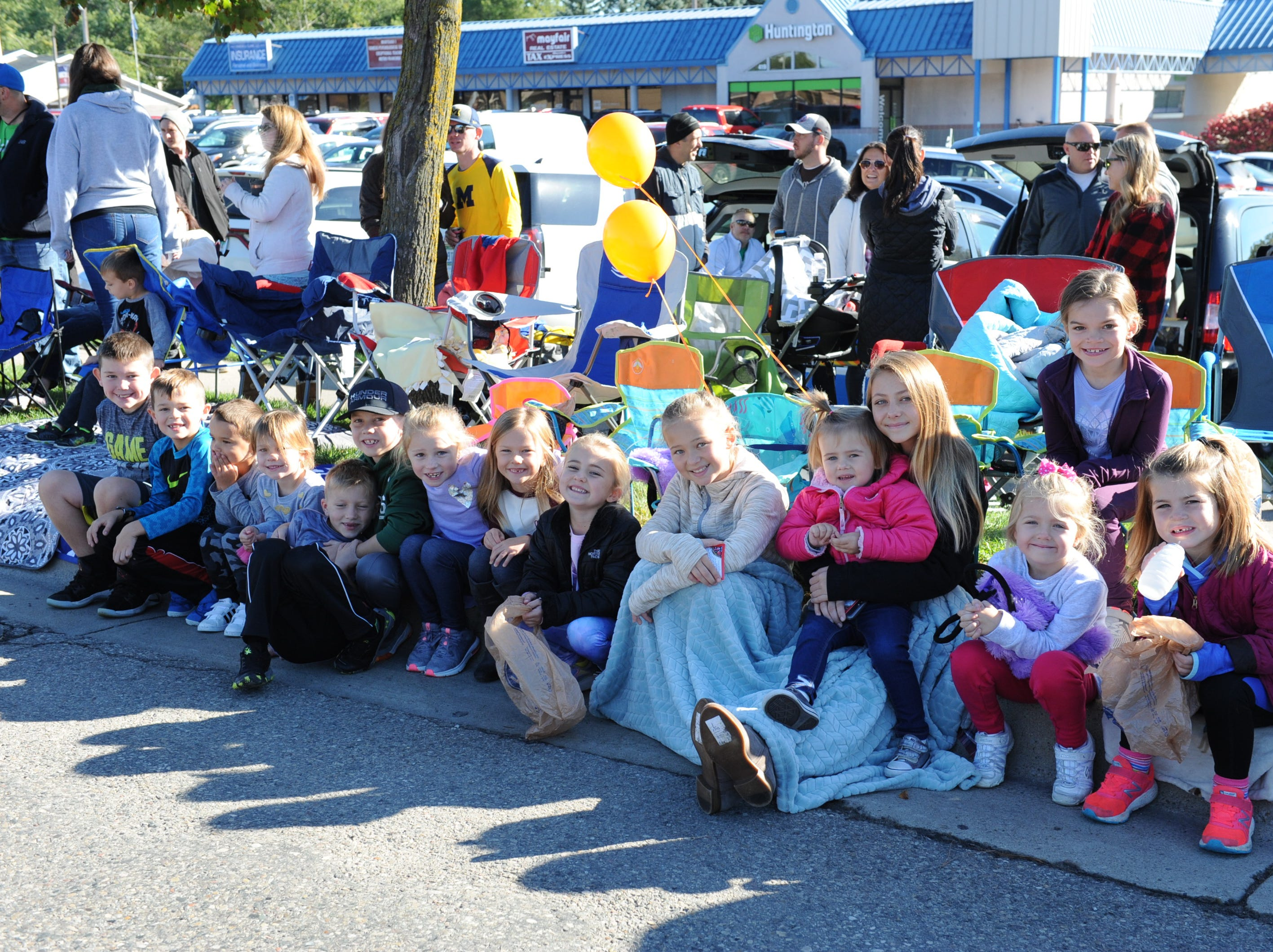 Kids of all ages gather as the annual Pumpkin Parade takes to the streets of South Lyon Saturday morning.