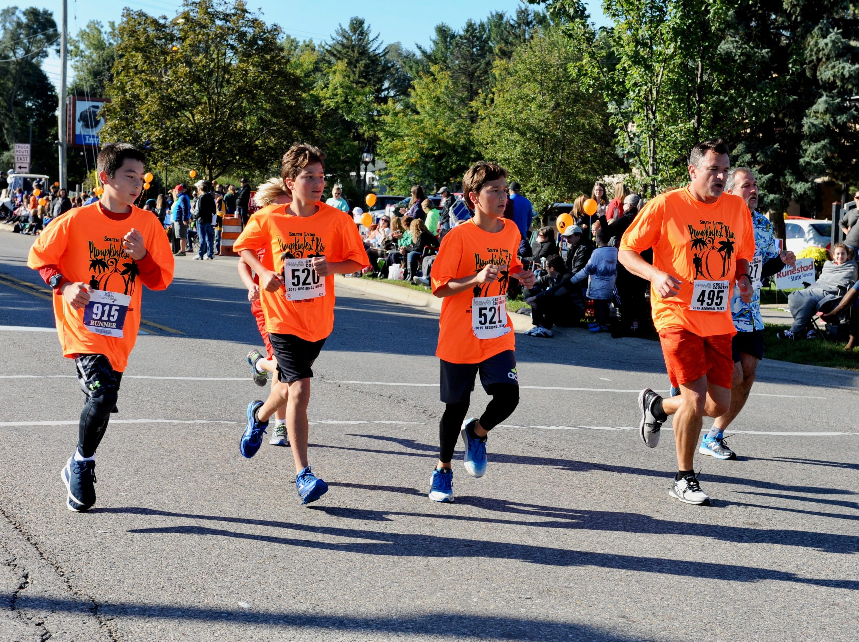 Runners take part in the 5K run in downtown South Lyon.