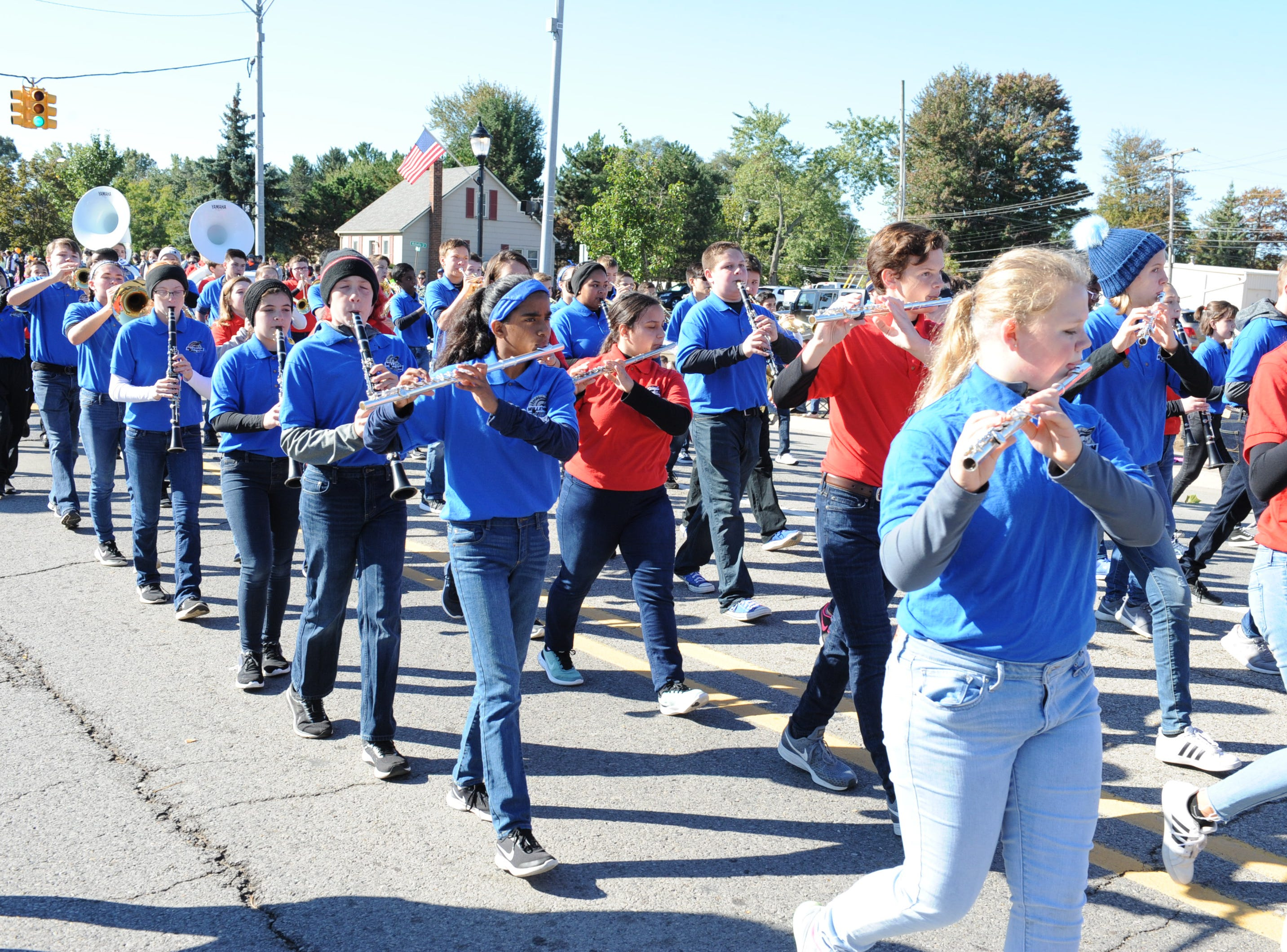 Combined South Lyon middle school marching bands in the annual parade.