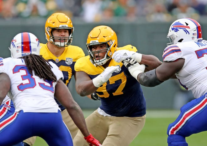 Green Bay Packers nose tackle Kenny Clark (97) rushes against the Buffalo Bills Sunday September 30, 2018 at Lambeau Field in Green Bay, Wis.