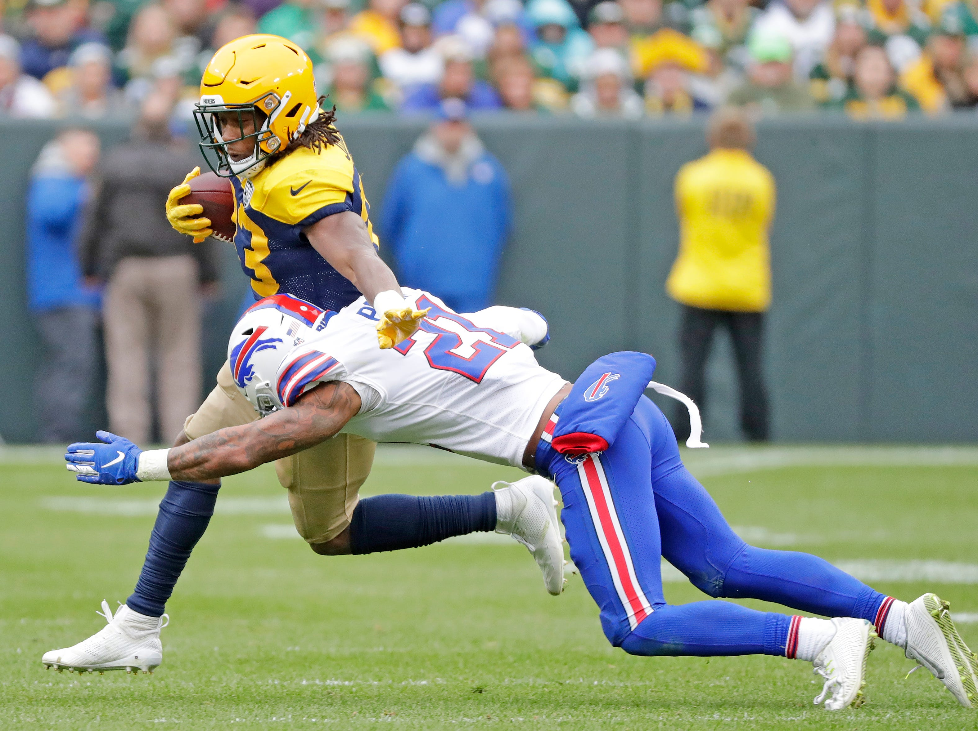Green Bay Packers running back Aaron Jones (33) rushes against the Buffalo Bills at Lambeau Field on Sunday, September 30, 2018 in Green Bay, Wis.Adam Wesley/USA TODAY NETWORK-Wisconsin