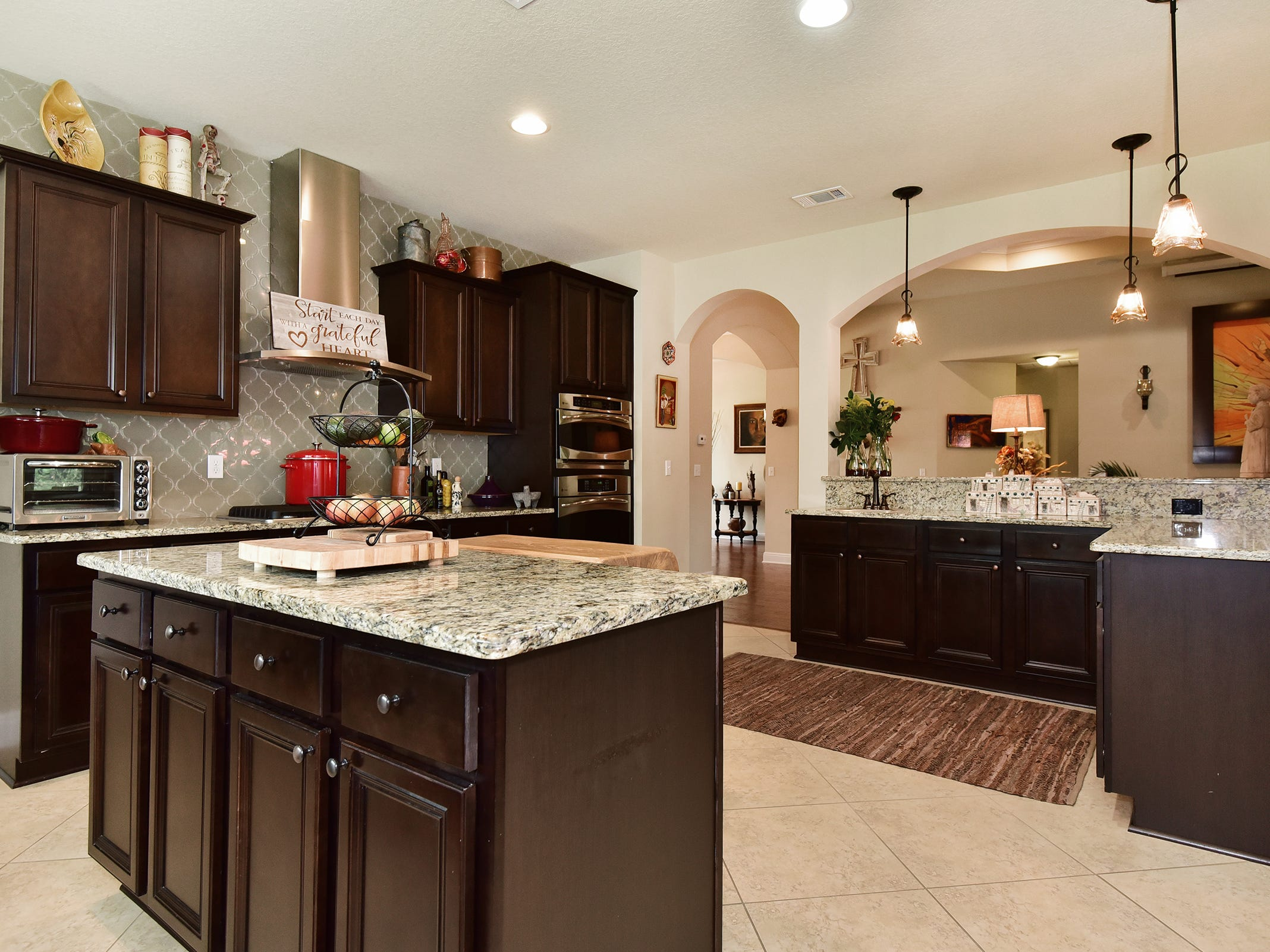8811 Salt Grass Drive, the kitchen includes a large island.