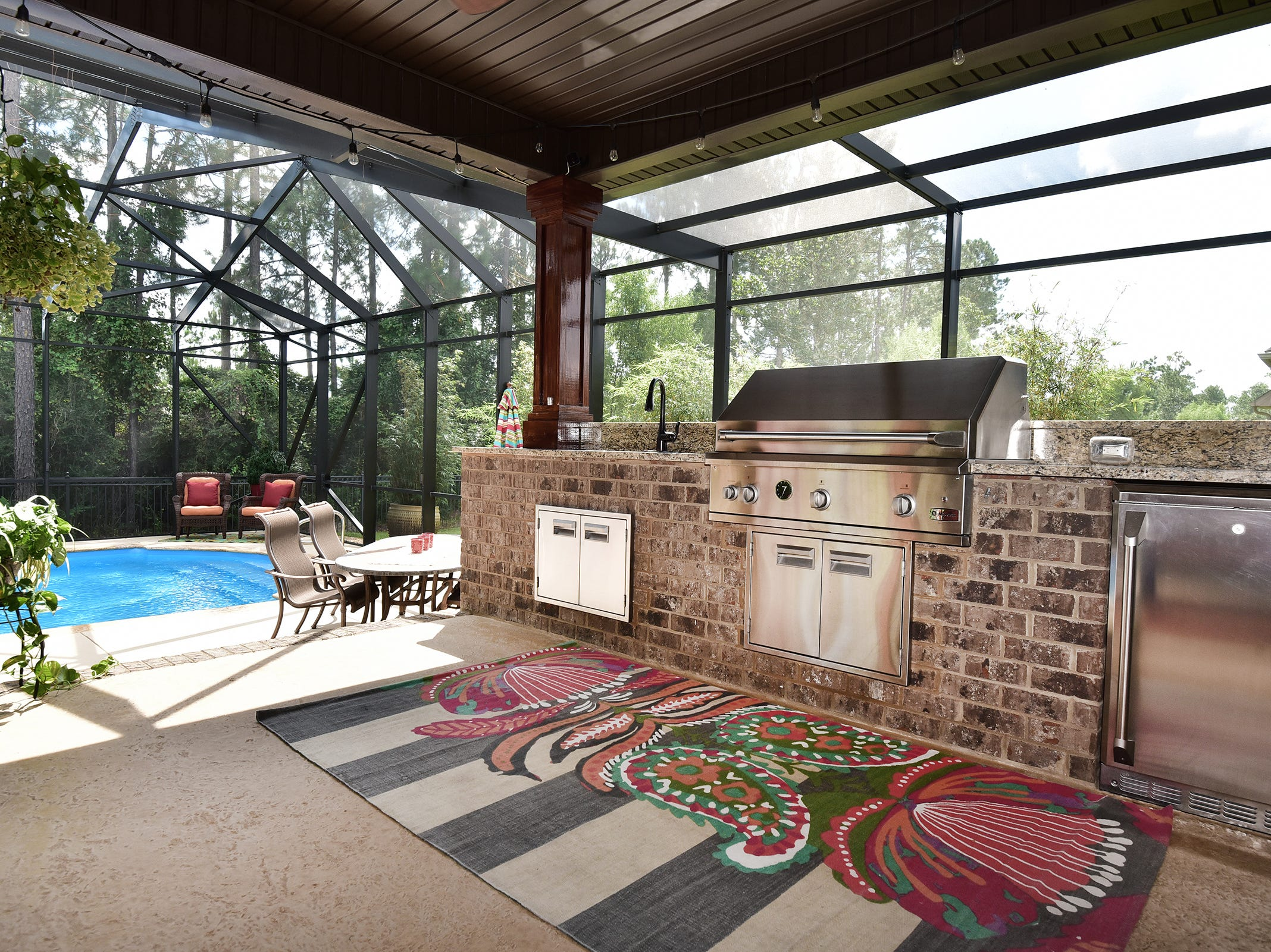 8811 Salt Grass Drive, the buil-in outdoor kitchen is perfect for meals al fresco.