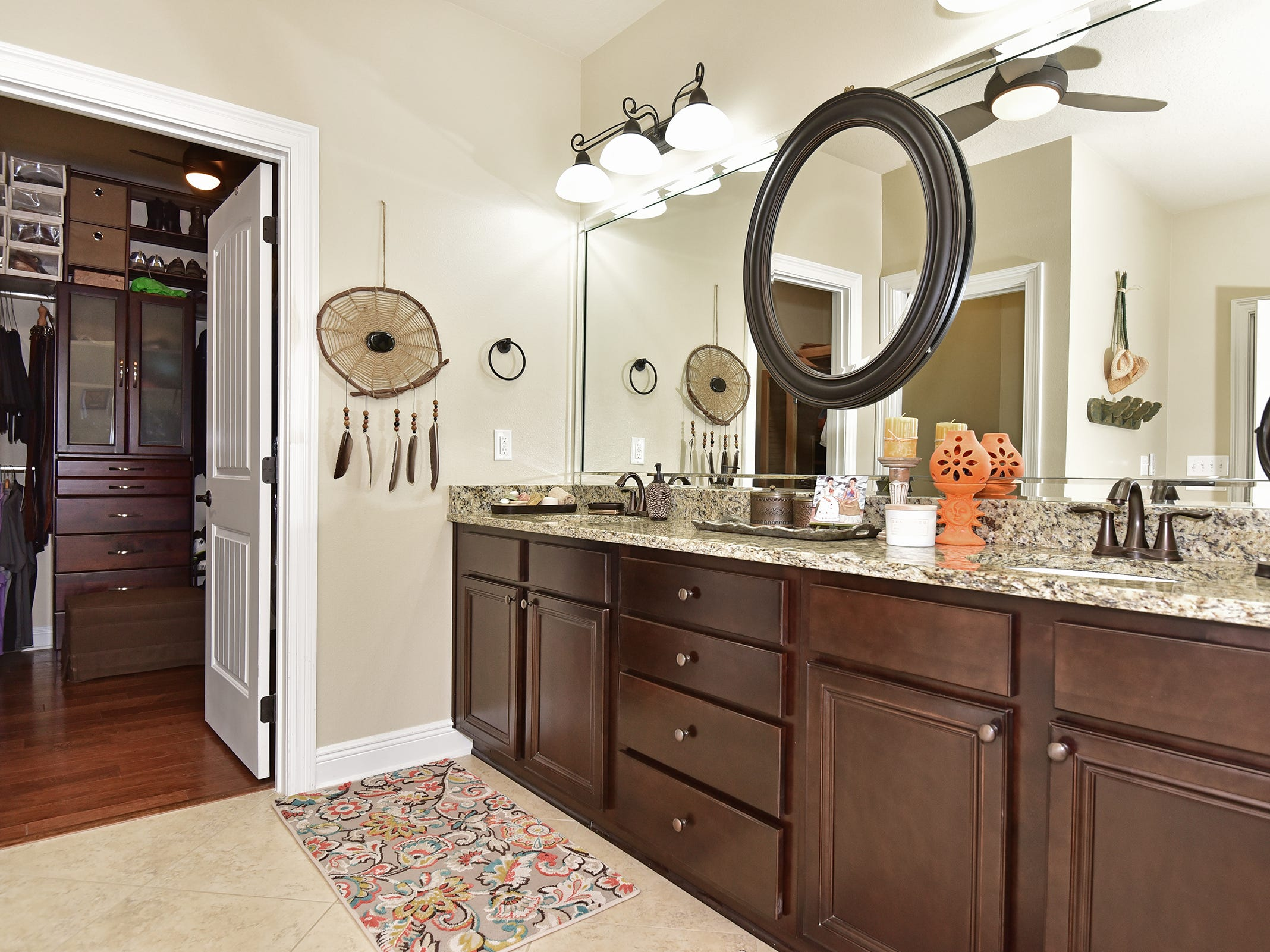 8811 Salt Grass Drive, the master bath includes abundant vanity space.