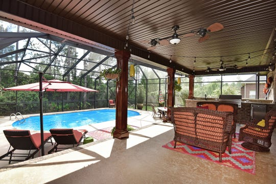 8811 Salt Grass Drive, enjoy shade by the pool.