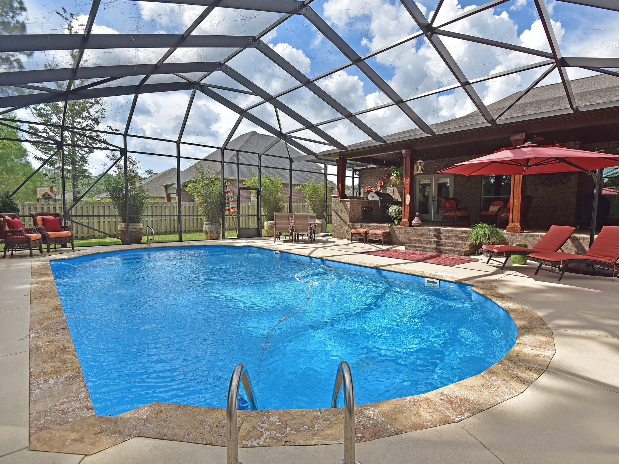 8811 Salt Grass Drive, the screen enclosed pool and deck space.