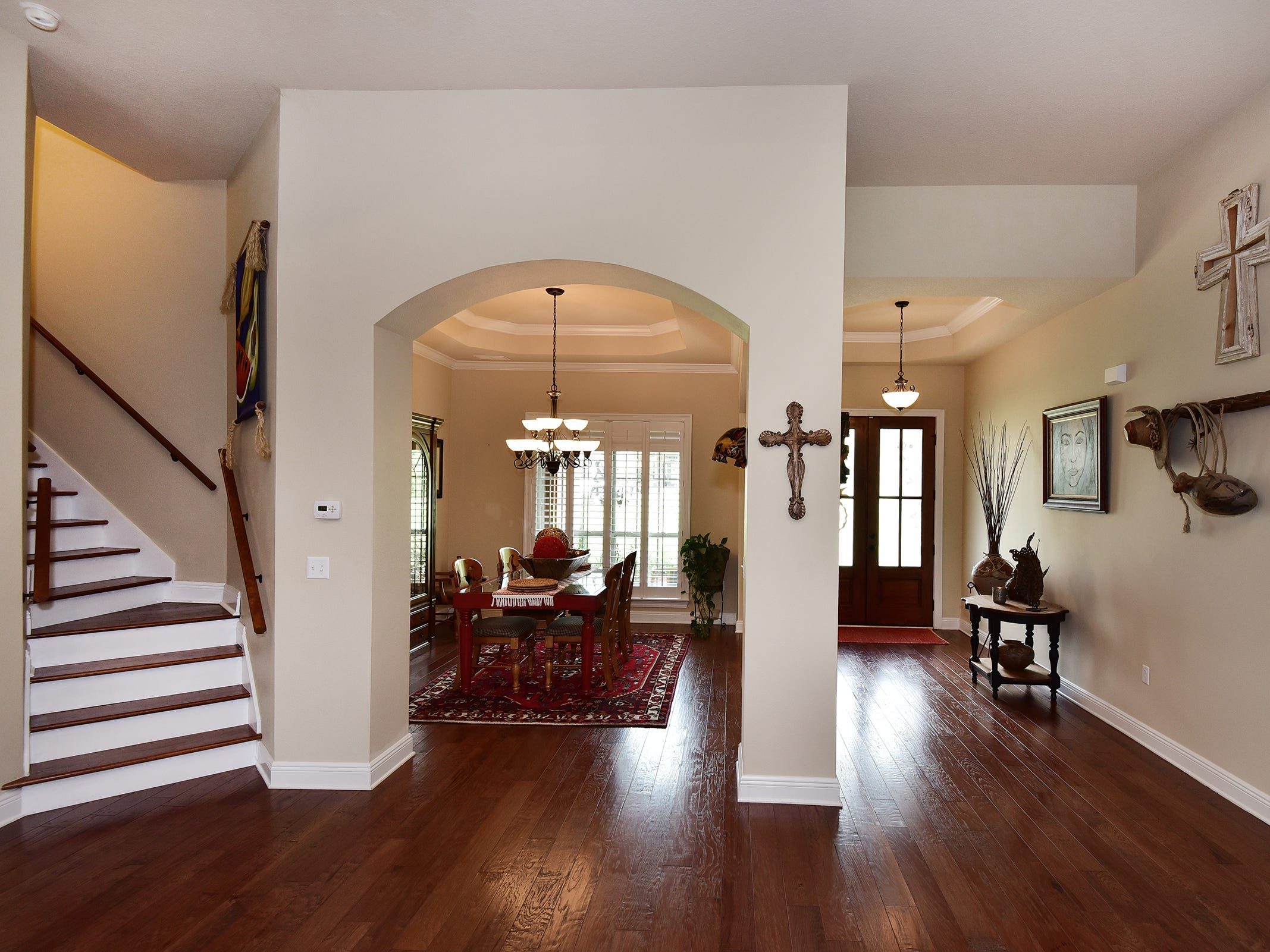 8811 Salt Grass Drive, the formal dining space is at the front of the home.