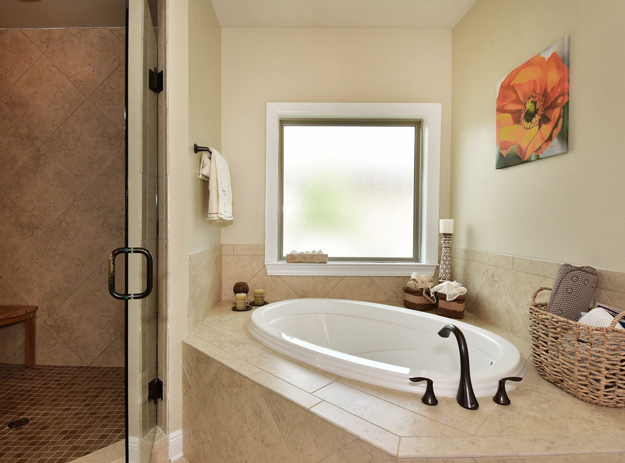 8811 Salt Grass Drive, the spa-like master bath.