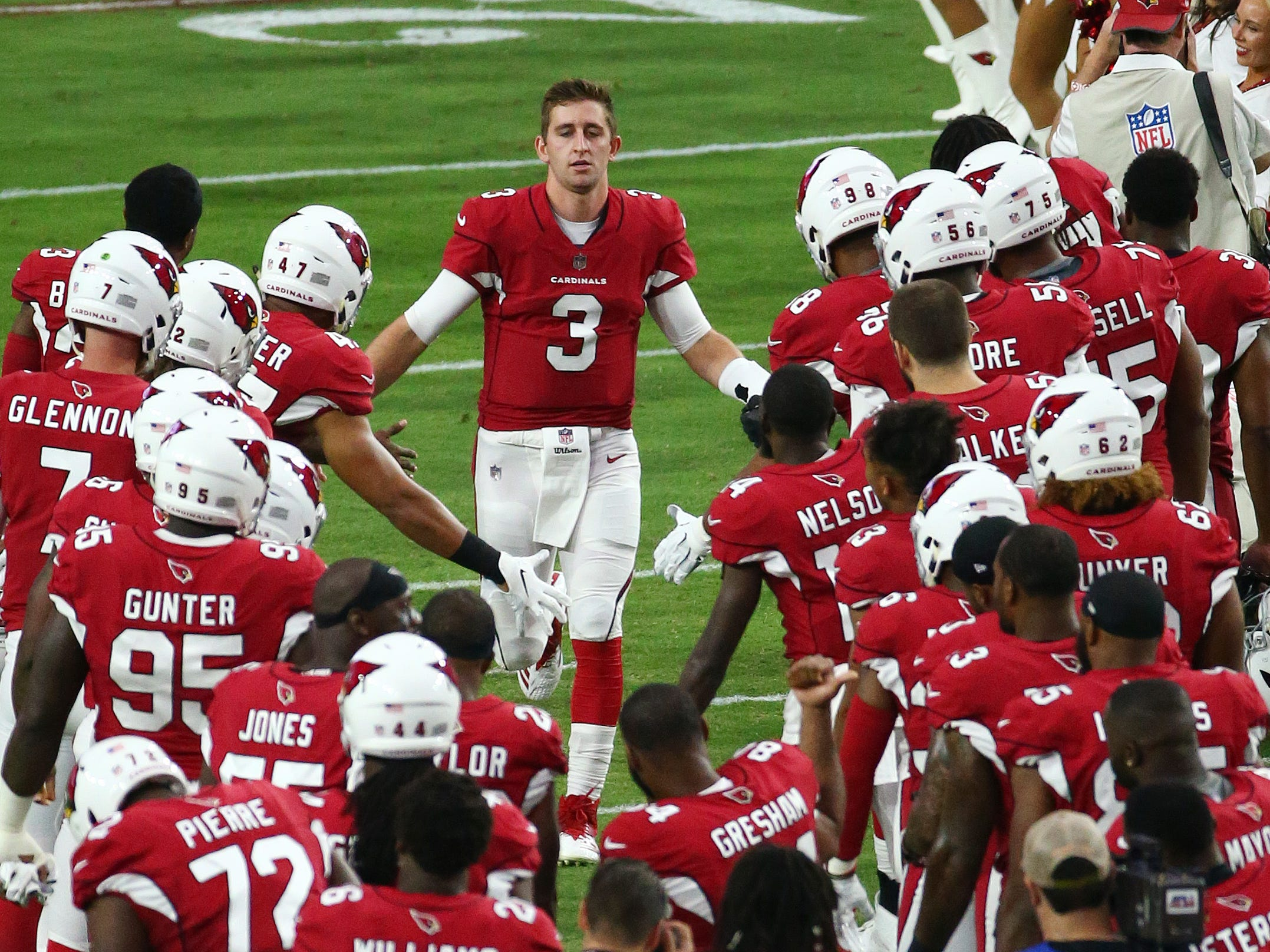 Arizona Cardinals quarterback Josh Rosin takes the field against the Seattle Seahawks at State Farm Stadium in Glendale,  Ariz.