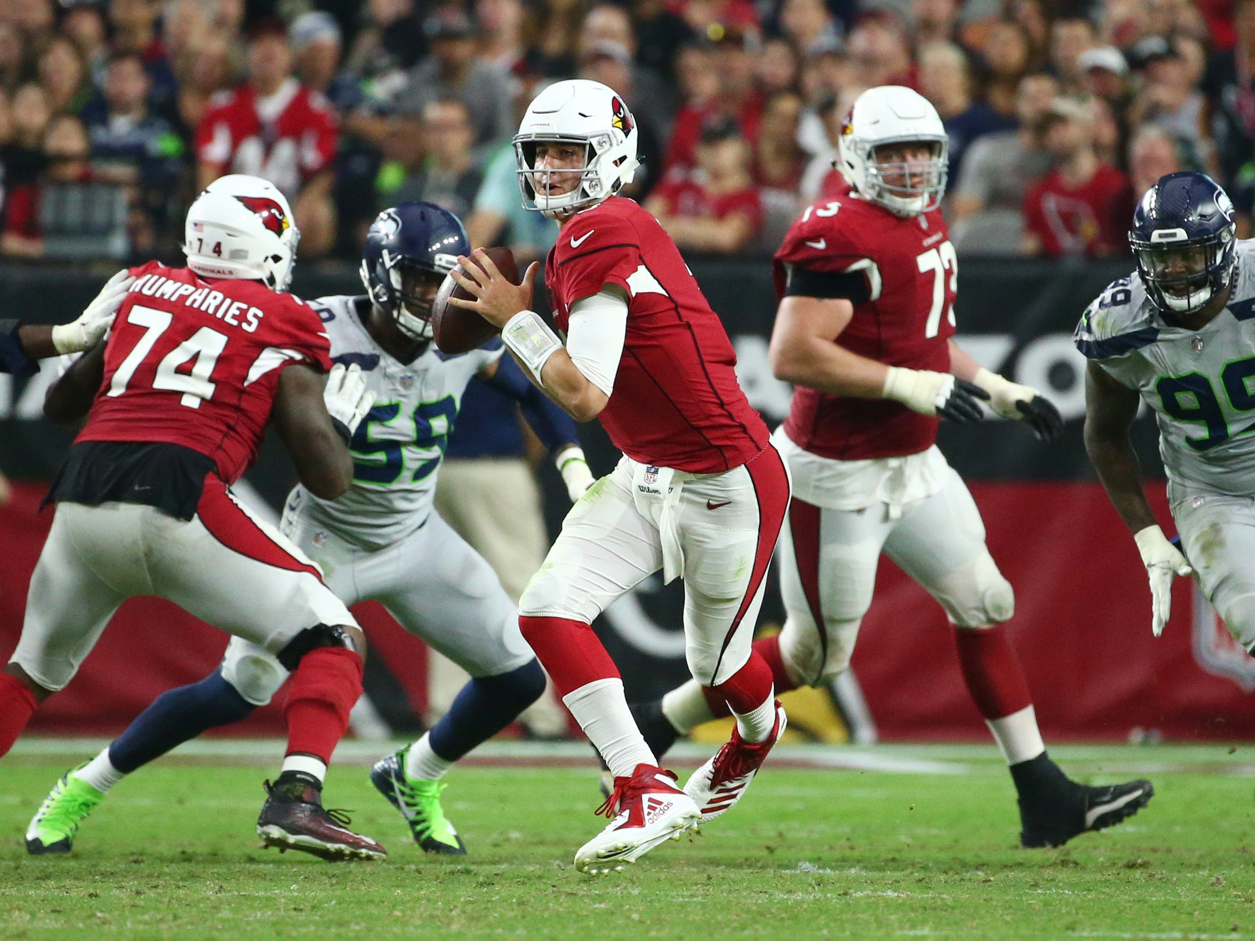 Arizona Cardinals quarterback Josh Rosin looks to throw against the Seattle Seahawks in the second half at State Farm Stadium in Glendale, Ariz.