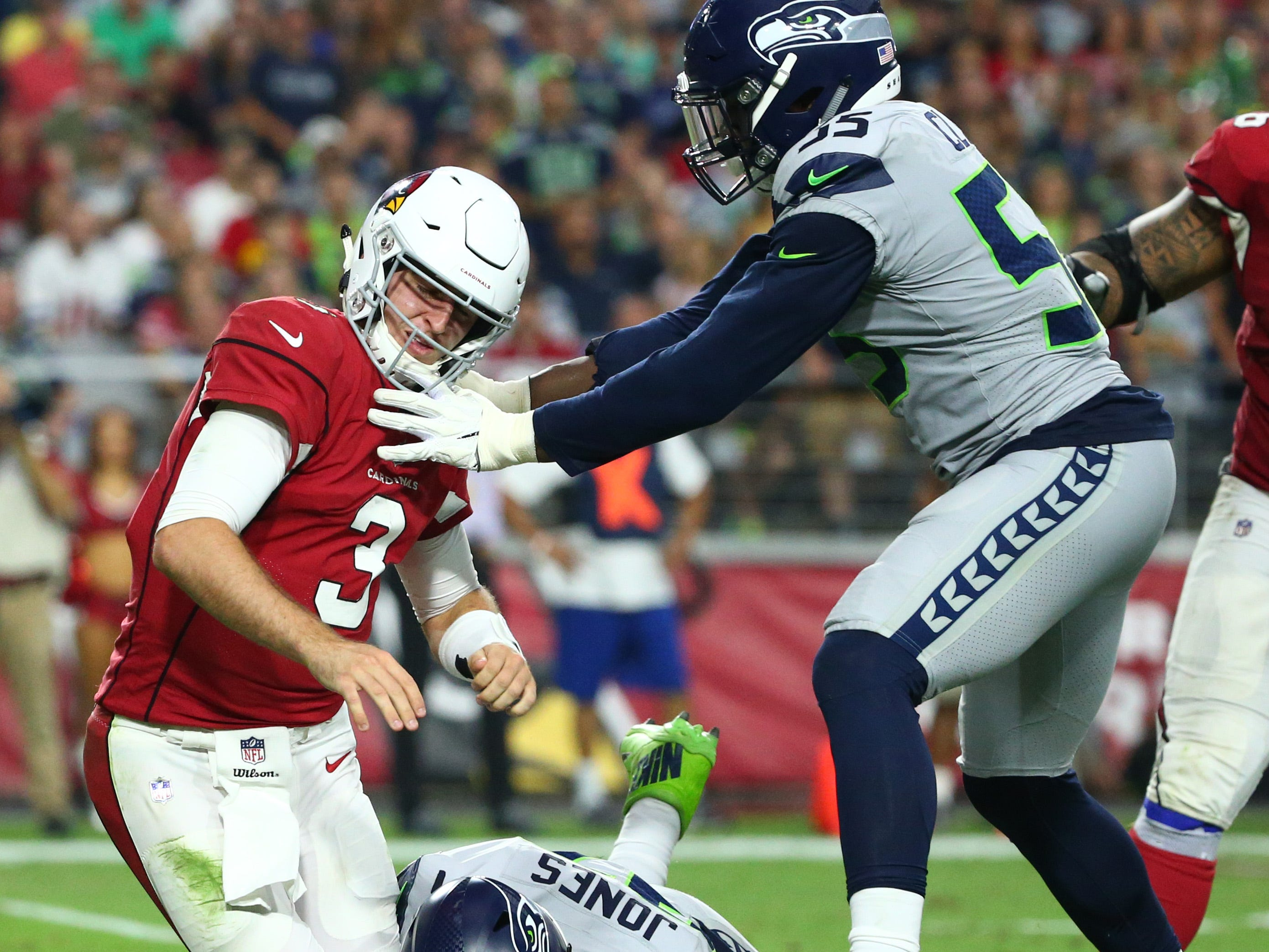 Arizona Cardinals quarterback Josh Rosin is pressured by the eattle Seahawks in the second half at State Farm Stadium in Glendale, Ariz.