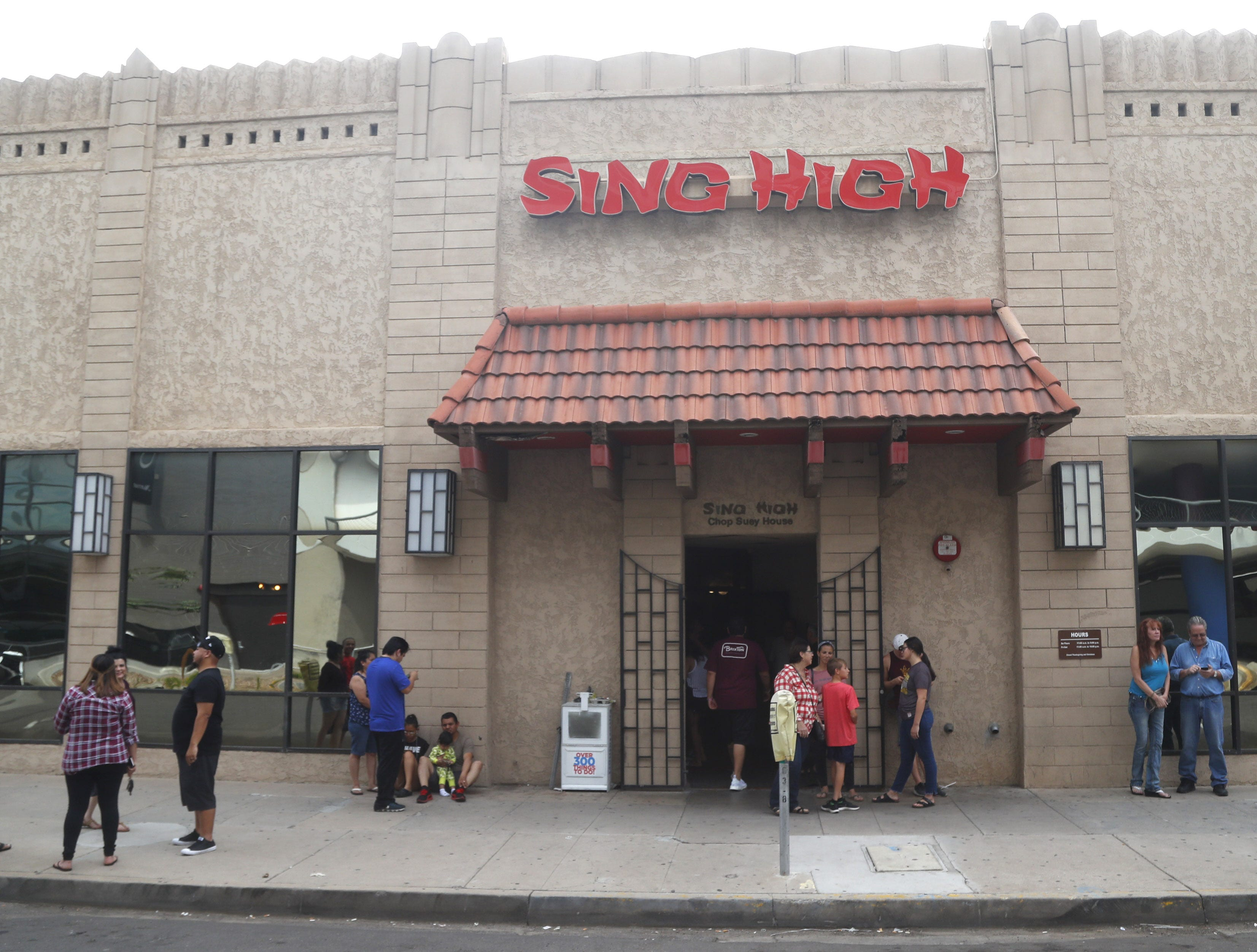People wait to eat at Sing High Chop Suey House in downtown Phoenix, Ariz. on Sept. 30, 2018.