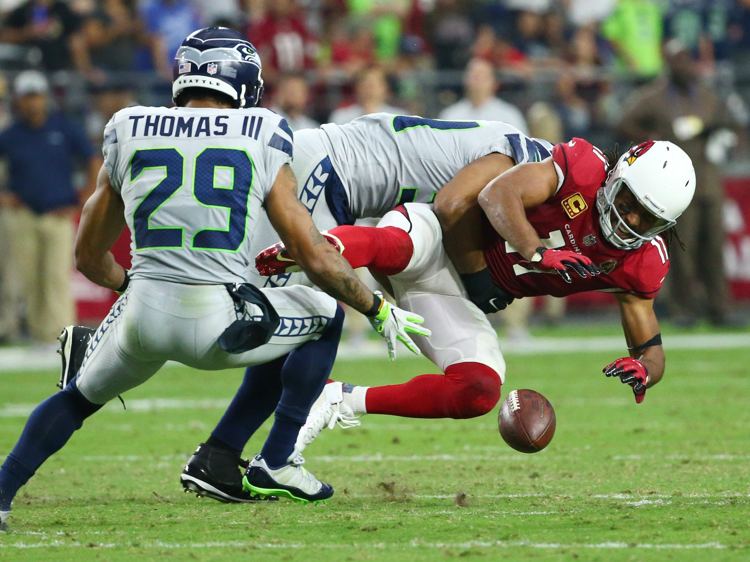 Arizona Cardinals Larry Fitzgerald misses the catch against the Seattle Seahawks in the first half at State Farm Stadium in Glendale,  Ariz.