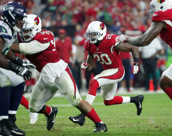 Arizona Cardinals linebacker Deone Bucannon (20) reacts to a play against the Seattle Seahawks during the third quarter at State Farm Stadium in Glendale, Ariz. September 30, 2018.