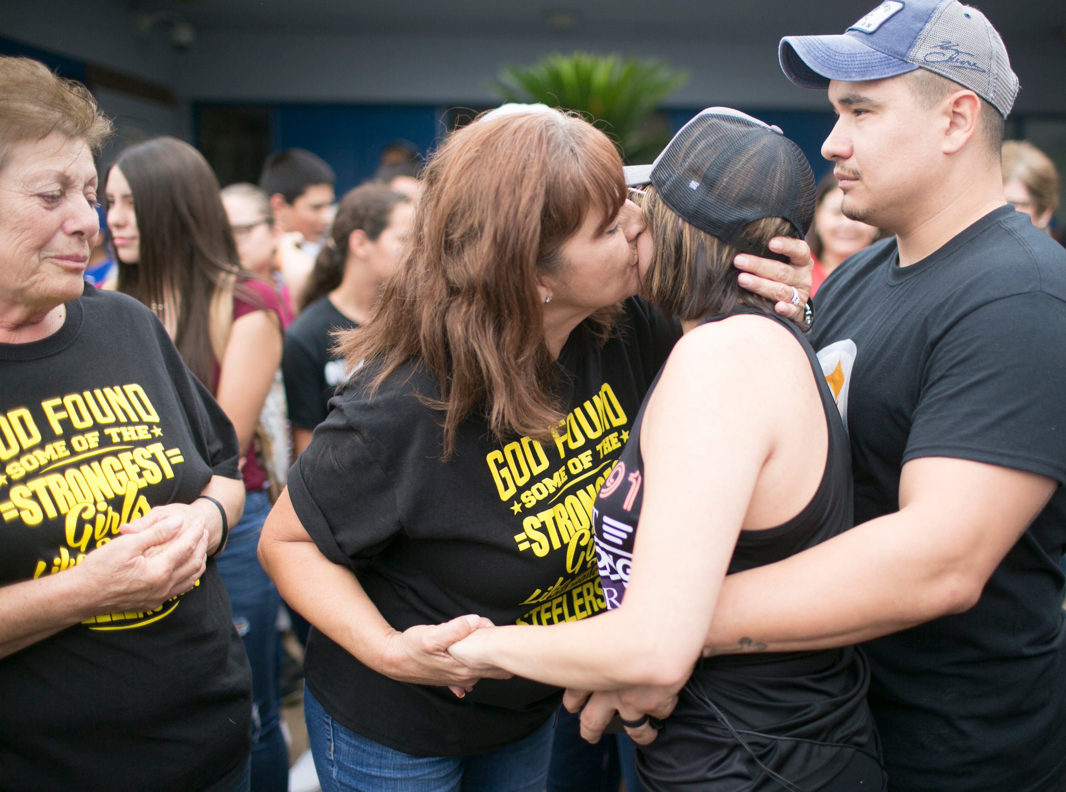 Barb Martinez hugs her daughter Jovanna Calzadillas after a balloon release to honor the 48 people killed in the mass shooting at the Route 91 Harvest Festival in Las Vegas. Calzadillas was severely wounded in the attack and has spent the past year in physical therapy. Jovanna and her husband Frank Calzadillas spent the one year anniversary of the shooting  with family and friends at Hayden High School.
